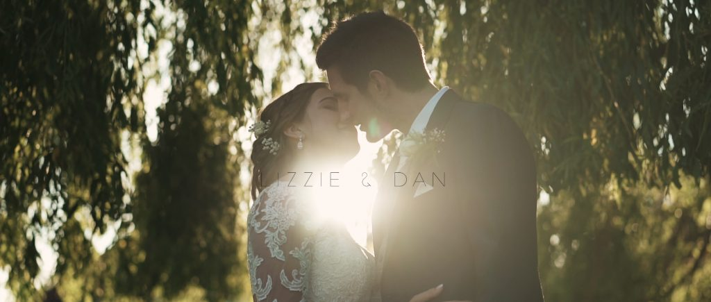 High house wedding couple kissing in sunset