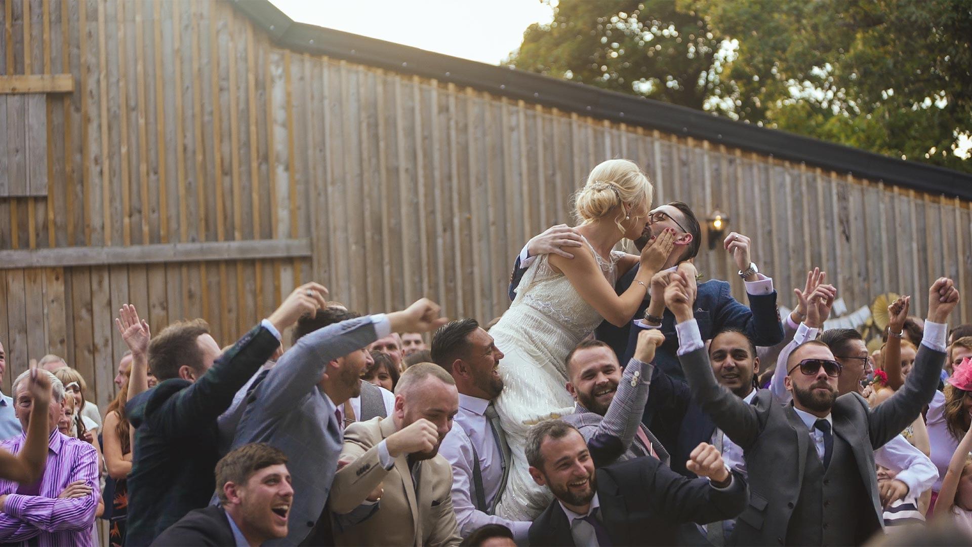 fun wedding crowd surfing couple